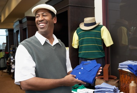 Man in a Golf Shop Stock Photo - 5404559