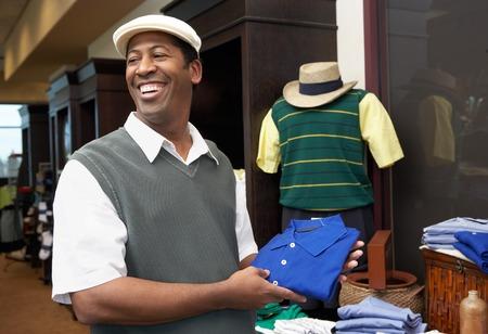 blacks: Man in a Golf Shop