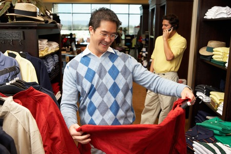 Two Men in a Golf Shop Stock Photo - 5404560