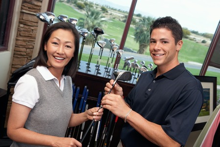 athletic gear: Couple in a Golf Shop