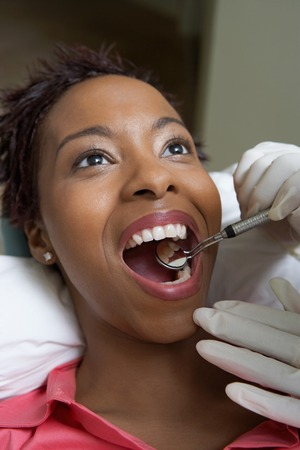 mouth opened: Woman Getting Dental Exam