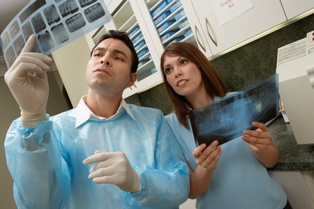 Dentist and Hygienist Examining X-rays Stock Photo - 5404622
