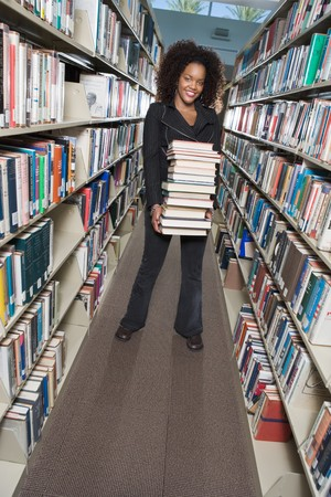 College Student with a Stack of Books Stock Photo - 5438257
