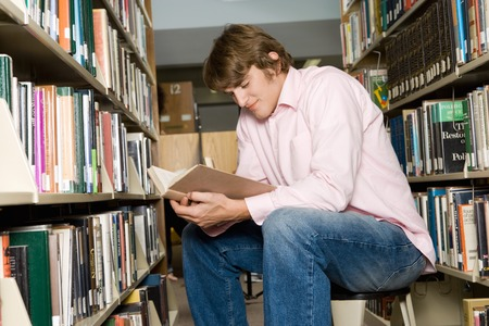 College Student Reading in the Library Stock Photo - 5438261