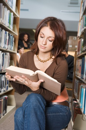 College Student Reading in the Library Stock Photo - 5438262