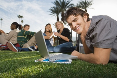 College Students Studying in the Grass Stock Photo - 5438267