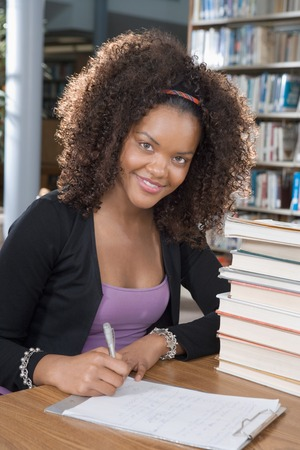 university text: College Student Studying at the Library LANG_EVOIMAGES
