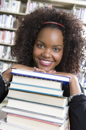 Female University student in library, portrait Stock Photo - 5404536