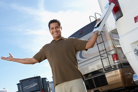 sales rep: Happy Salesperson on RV Lot LANG_EVOIMAGES