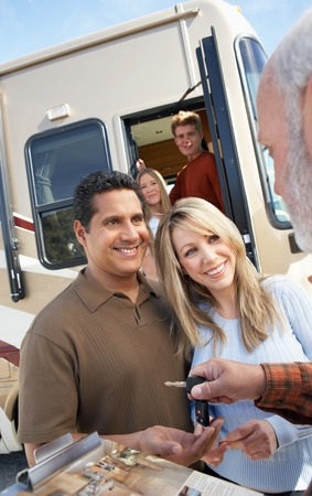 purchasing: Couple Receiving Keys to New RV from Dealer