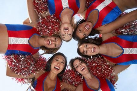 low spirited: Cheerleaders in a Huddle