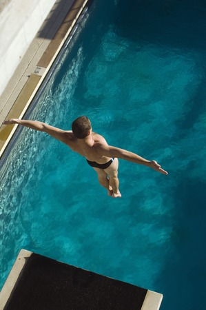 Swimmer jumping into swimming pool Stock Photo - 5404483