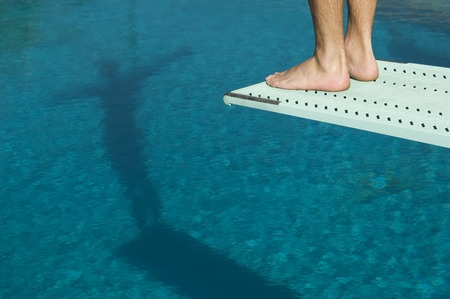 Male swimmer standing on diving board Stock Photo - 5404468