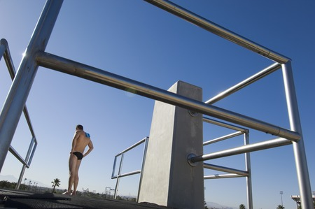 Swimmer standing on diving board Stock Photo - 5404461