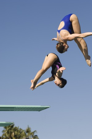 somersault: Two women diving from diving board