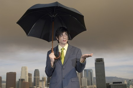 Businessman with Umbrella Stock Photo - 5438297