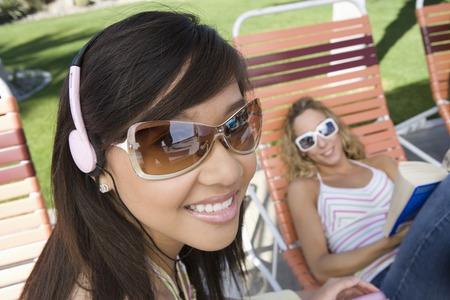 Young women relaxing outdoors Stock Photo - 5404393