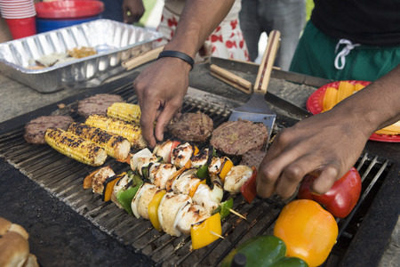 Burgers and kebabs on barbecue grill Stock Photo - 5404267