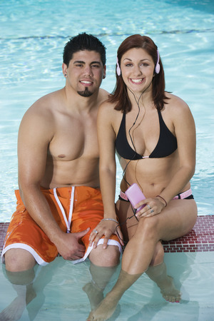 Young couple relaxing in swimming pool, portrait Stock Photo - 5404375