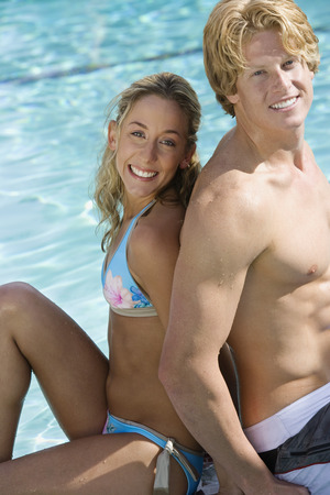 Portrait of young couple by swimming pool Stock Photo - 5404244