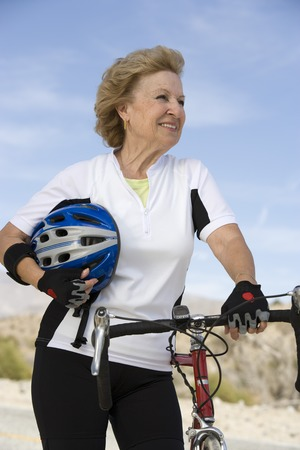 Senior woman with bike Stock Photo - 5404383