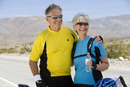 Senior couple in sportswear on roadside Stock Photo - 5438319
