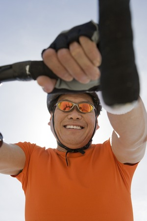Senior man cycling, low angle view Stock Photo - 5438329