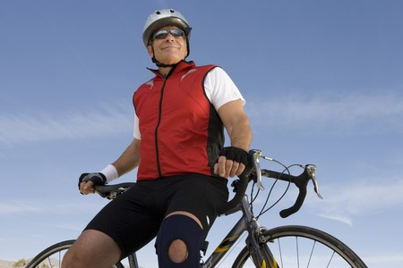 Senior man leaning on bike Stock Photo - 5438336