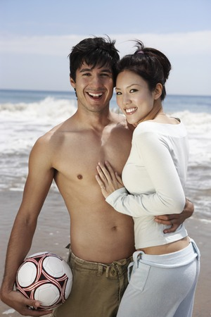 Couple with Volleyball Stock Photo - 5438361