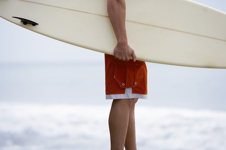 athletic gear: Surfer with Surfboard