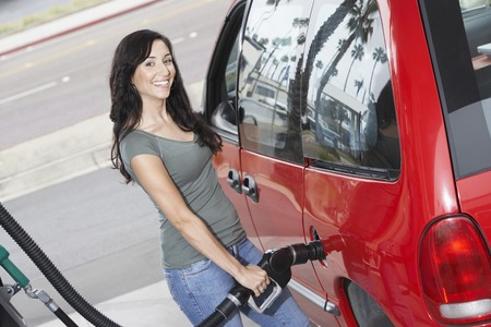 Young Woman Filling Up at the Gas Station Stock Photo - 5438389