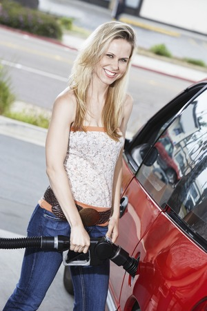 Young Woman Filling Up at the Gas Station Stock Photo - 5438390