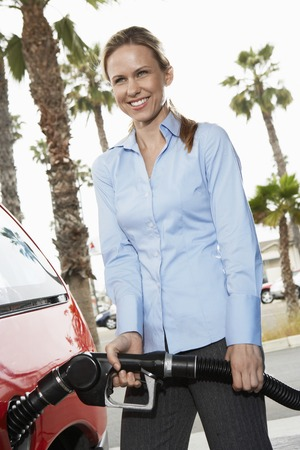 Young Woman Filling Up at the Gas Station Stock Photo - 5438395