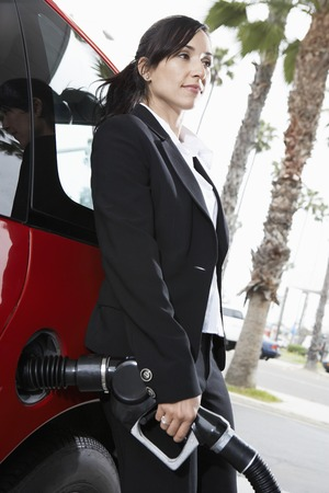 fuelling pump: Businesswoman Filling Up at the Gas Station