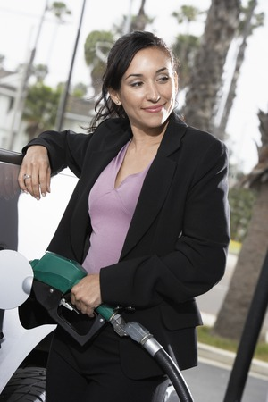 Businesswoman Filling Up at the Gas Station Stock Photo - 5438398