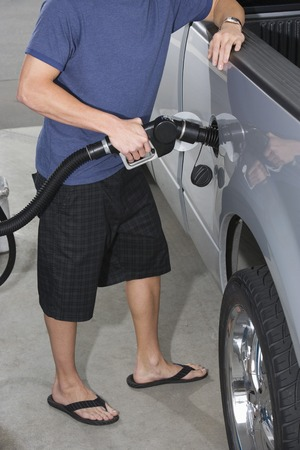 Young man with fuel pump Stock Photo - 5438407