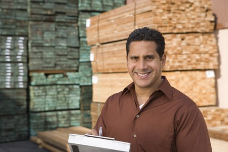 Mid-adult man stock-taking in warehouse Stock Photo - 5438462
