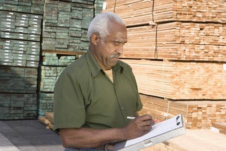 Senior man stock-taking in warehouse Stock Photo - 5438464