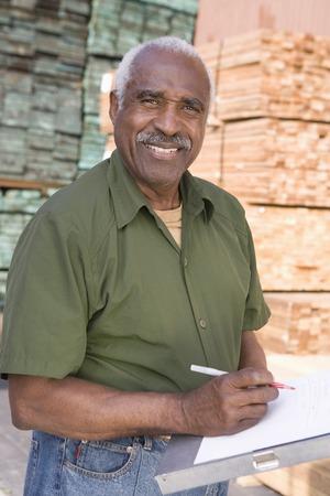 Senior man stock-taking in warehouse Stock Photo - 5438465