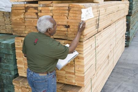 Senior man stock-taking in warehouse Stock Photo - 5438466