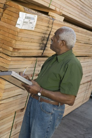 Senior man stock-taking in warehouse Stock Photo - 5438467