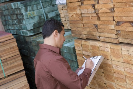 Mid-adult man stock-taking in warehouse Stock Photo - 5438468