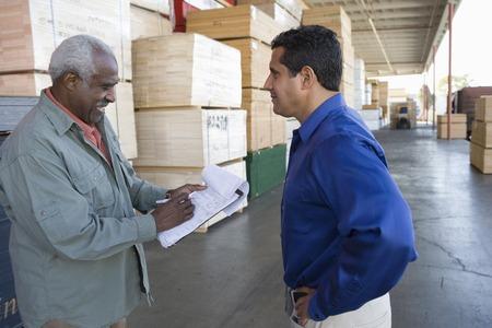 Men stock-taking in warehouse Stock Photo - 5449519
