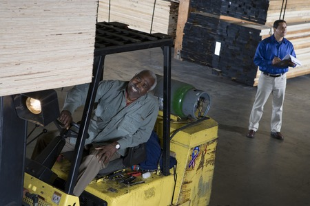 Warehouseman and forklift truck driver Stock Photo - 5449522