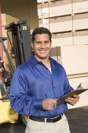 warehouseman: Mid-adult warehouseman LANG_EVOIMAGES