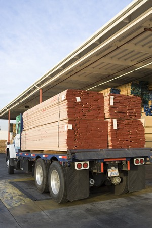 Truck loaded with wood outside warehouse Stock Photo - 5449550