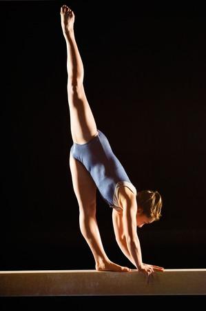 teenaged girl: Gymnast on Balance Beam