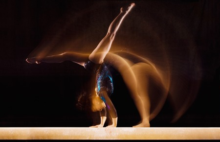 female gymnast: Gymnast Doing Cartwheel on Balance Beam