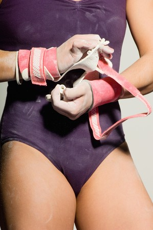 Gymnast Putting on Palm Guards Stock Photo - 5449560