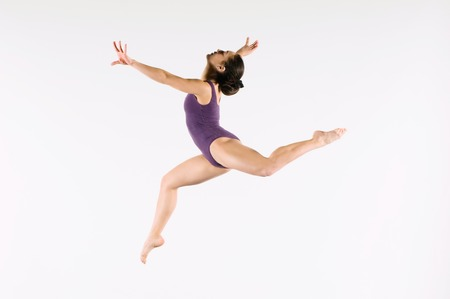 Young Gymnast Mid-air during Jump Stock Photo - 5449561